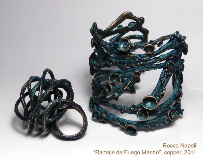 "RAMAJE DE FUEGO MARINO Bracelet and Ring, oxidized copper, metal casting work, one of a kind. 2011. ""Creación en Cobre"" contest exhibition, MAC museum, Santiago de Chile."