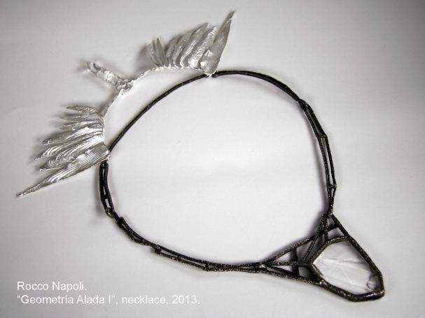 """GEOMETRIA ALADA I · (WINGED GEOMETRY I) Necklace, silver 950, oxidized silver and rock crystal. Metal casting, one of a kind. 2013. Showed at """"Delirio & Cordura"""" exhibition, Scuola Cultural Center and Museum of Decorative Arts, Santiago de Chile."""