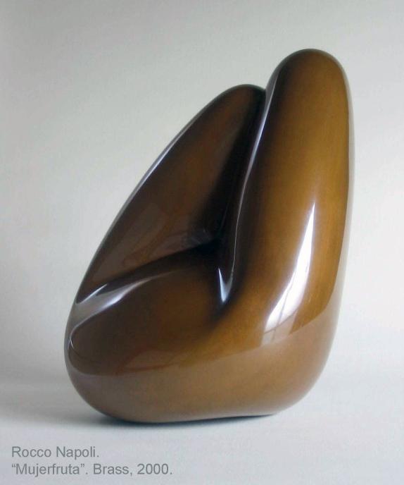"MUJERFRUTA Sculpture, 48 cm in length, brass, metal casting work. 2001. Showed at ""PANGAEA"" exhibition, Tachikawa Art Festival, Japan. 2006. Showed at ""LABERINTOS DE AMOR Y EROTISMO"" exhibition, Casona Nemesio Antúnez, Santiago de Chile."